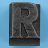 metal type letter R