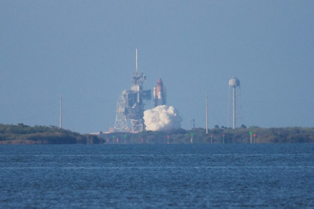 STS-133 Discovery liftoff from Launch Pad 39A