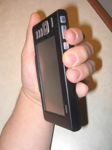 Nokia 770 with FBreader in rotated orientation, showing the rocker page control