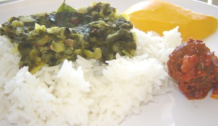 Fenugreek dal with gooseberry pickle and mango slice
