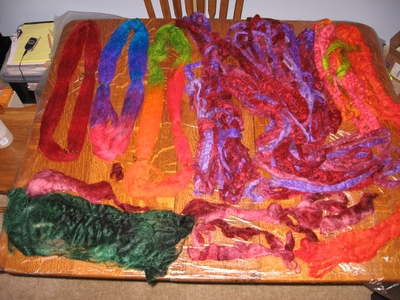 table full of drying yarn and fleece