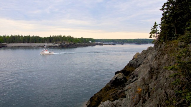 Fishing boat heading out to sea as I photographed East Quoddy Lighthouse