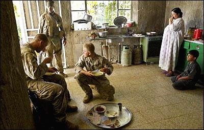 near haditha, US soldiers being fed by a family  AP photo