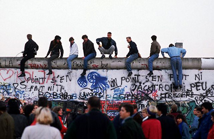 People sitting on Berlin Wall 12 Nov 1989