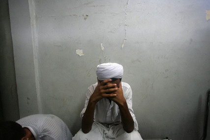Palestinian man weeps inside morgue prior to funeral in Gaza Jul 10 2006