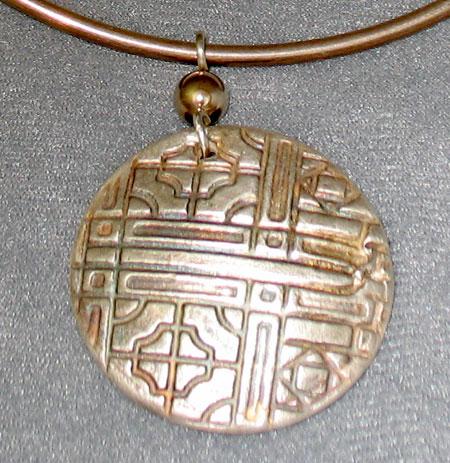 Fine silver over porcelein pendant