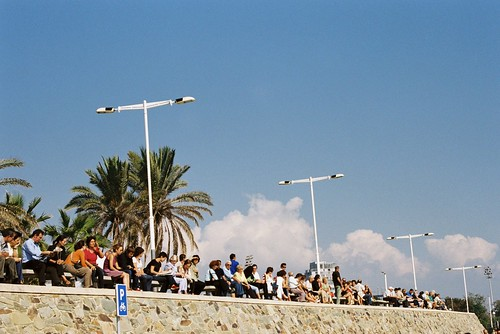 People sitting by the boardwalk