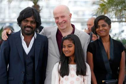 "Director Jacques Audiard and cast members pose during a photocall for the film ""Dheepan"" in competition at the 68th Cannes Film Festival in Cannes"