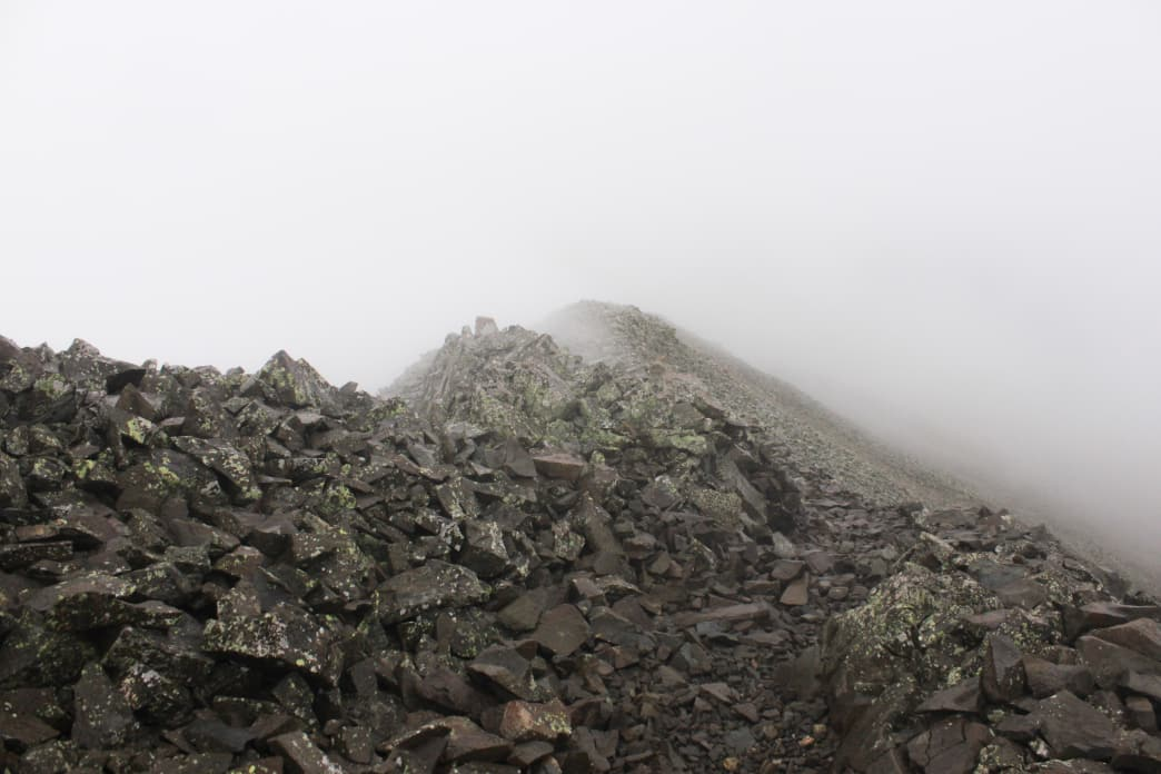 A technical, rocky, and fog-shrouded summit along the Colorado Trail—expect it all!     Richard Forbes