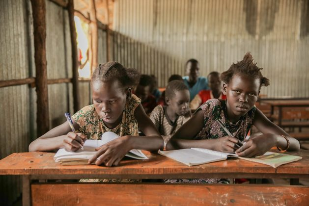 Education Cannot Wait's funding has helped provide education to 140,000 pre-primary, primary and secondary refugee school children — 38 percent of whom are girls — in the Gambella and Benishangul Gumuz regions. South Sudanese girls in grade two learning at Tierkidi School No. 3, Refugee Camp, Itang Woreda, Gambella Region. Credit: UNICEF Ethiopia/2018/Mersha