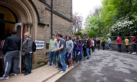 Voters queuing at polling station (from guardian.co.uk)