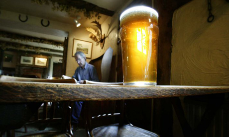 Man reading in pub