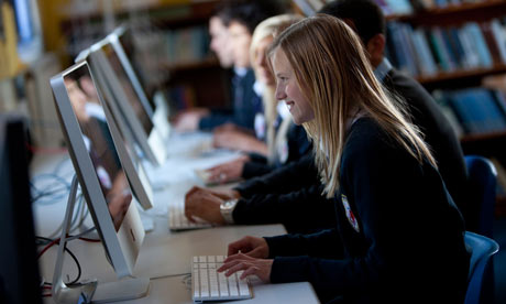 A teenage girl taking part in a computer science or ICT lesson at school.