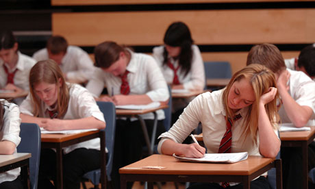 Pupils sit GCSE exams in a school hall
