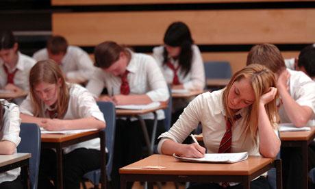 Pupils sit GCSE exams in a school hall