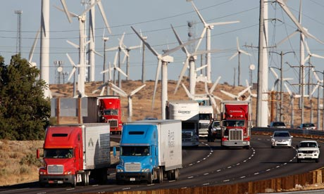 COP15: US carbon emissions from diesel trucks passing windmills of windfarm near Banning, California