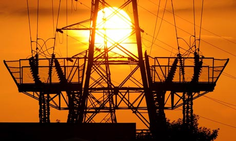 Electricity market reforms unveiled : The sun setting behind electricity pylons in Bromley