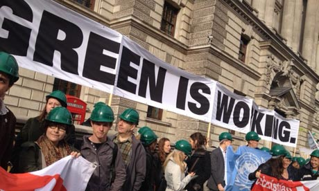 Activists from Stop Climate Chaos Coalition protest in front of the Treasury for green jobs
