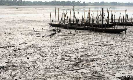 Fishing boats lie abandoned in oil-polluted water near Bodo, Nigeria.