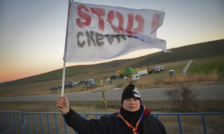 Stop Chevron at a makeshift camp erected by fracking for shale gas protesters in Romania