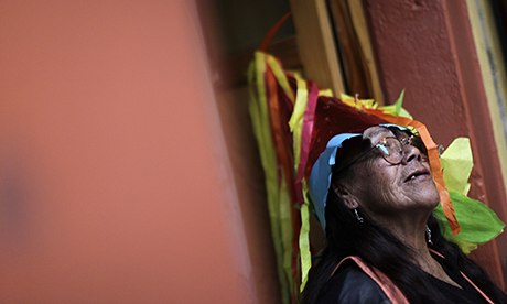 MDG: A former prostitute wears a piñata as a hat during Christmas celebrations in Mexico City