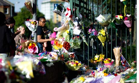 Flowers adorn the site where the soldier Lee Rigby was killed in Woolwich