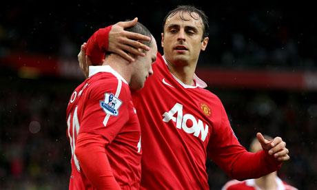 Wayne Rooney is congratulated by Dimitar Berbatov