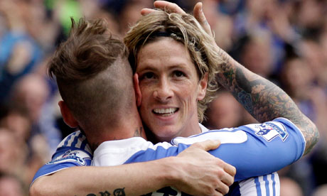 Meireles congratulates Torres on a job well done