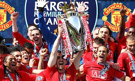 Manchester United's Gary Neville lifts the Premier League trophy
