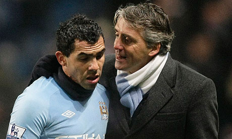 manchester city's carlos tevez and roberto mancini