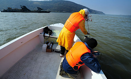 Environmental workers collect samples from the river Danube as it flows into Romania from Hungary.
