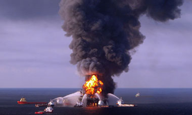 Boats battle the blazing remnants of BP's Deepwater Horizon rig in the Gulf of Mexico, April 2010