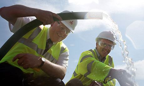 Professor Paul Younger (left) and Professor David Manning from Newcastle University prepare and test thermal water from their 400-metre borehole at Eastgate in Weardale. Photograph: Mike Urwin