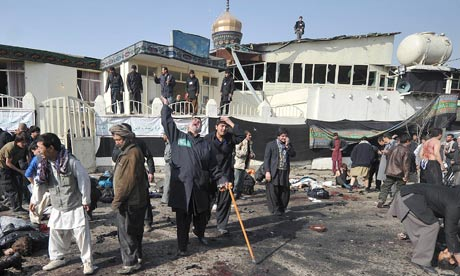The aftermath of a suicide bomb at a Shia shrine in Kabul 6 December 2011