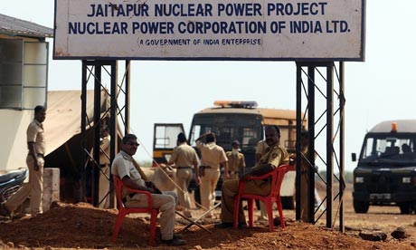 Police officers guard the proposed site of the nuclear power project near Jaitapur