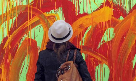 A woman looks at a painting by US painter Cy Twombly