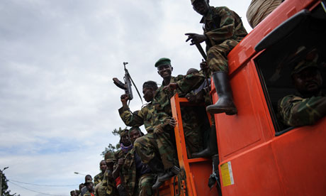 M23 rebels celebrate in the streets after taking Goma.