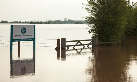 An Environment Agency sign for Curry Moor pumping station in Somerset, submerged by floods in May.