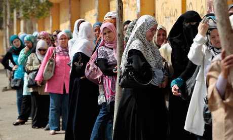 Egyptian women wait to cast their vote in Cairo