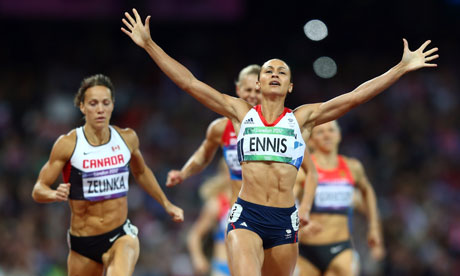 Jessica Ennis crosses the finish line in the 800m to take gold in the women's heptathlon.
