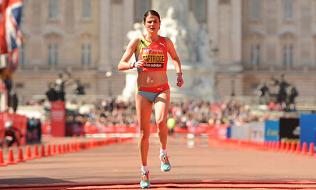 Susan Partridge crosses the finish line at the 2013 London marathon