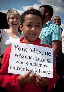 A young member of York mosque displays his message.