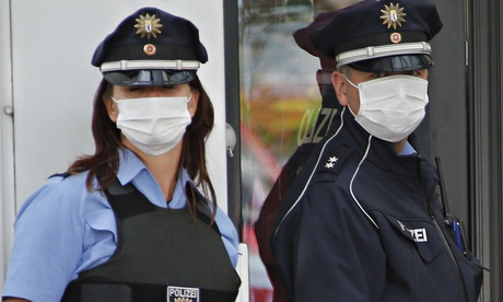 German police officers wearing protective masks
