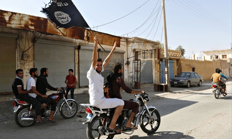 Isis supporters waving flag on motorcycle in Tabqa