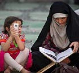 An Iranaian woman and her daughter at a mosqueduring Ramadan.