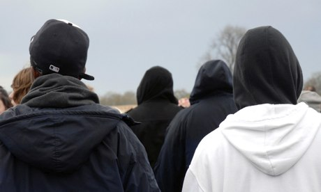 Gang of hooded youth moving through crowd. Image shot 2008. Exact date unknown.