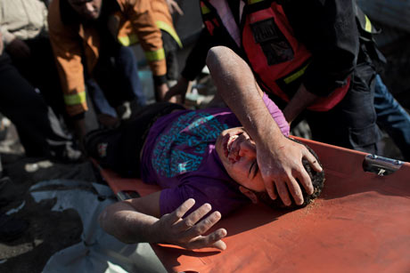 Osama Abdel Aal is rescued after his family house collapsed during an Israeli strike in Tufah, Gaza