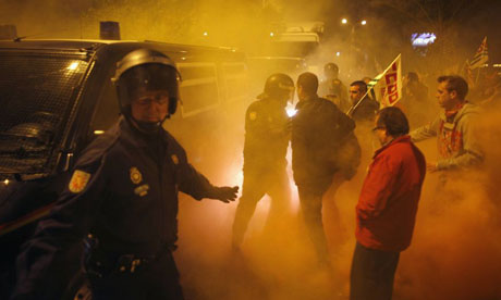 Thursday 29 March 2012 General Strike Spain. Police try to escort a truck leaving a food warehouse past picketers in Malaga, southern Spain, at the start of a general strike.Photograph: Jon Nazca/Reuters