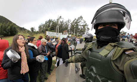 Demonstrators and riot policemen near Bogota Colombia