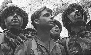 Israeli paratroopers Zion Karasente, Isack Ifat and Haim Oshiri view the Western Wall, following fierce fighting for the Old City during the six-day war in 1967